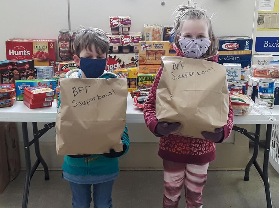 children bringing donations for souper bowl Sunday